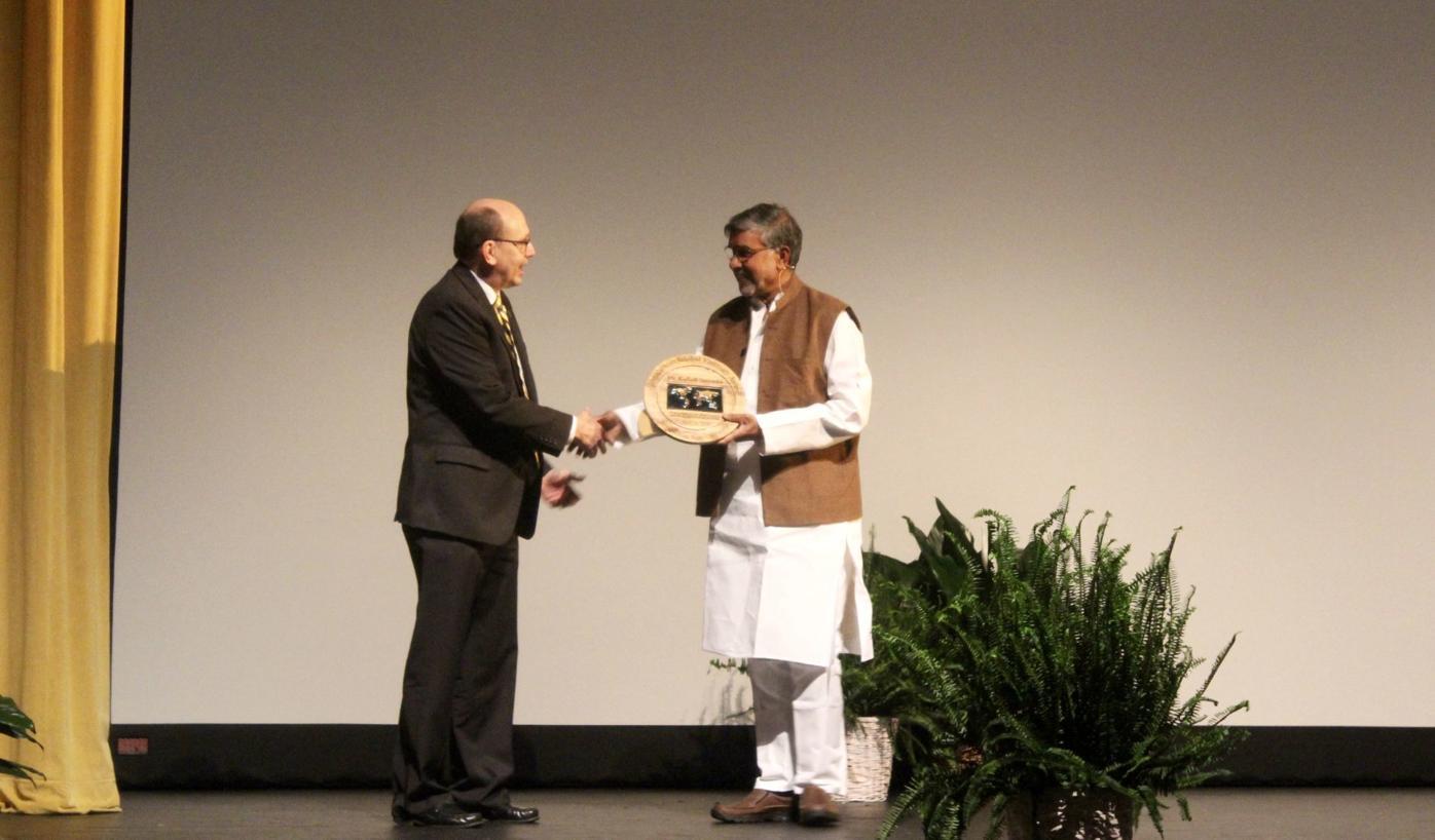 Kailash accepting award