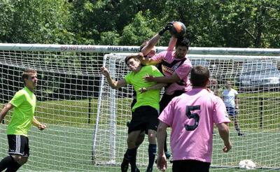 AMB Adult Soccer League Gold Division teams in action.