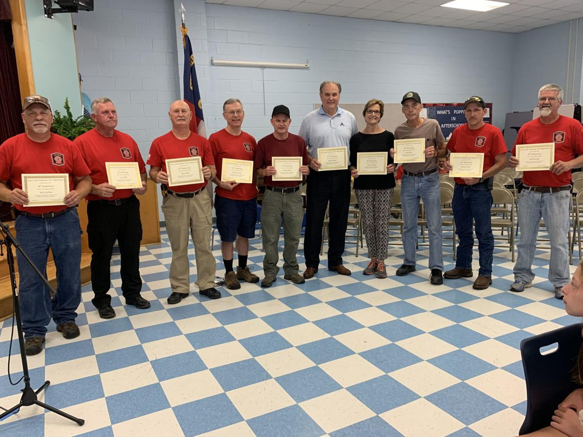 Volunteer fire fighters who have 20 or more years of service were recognized by Sue Jackson