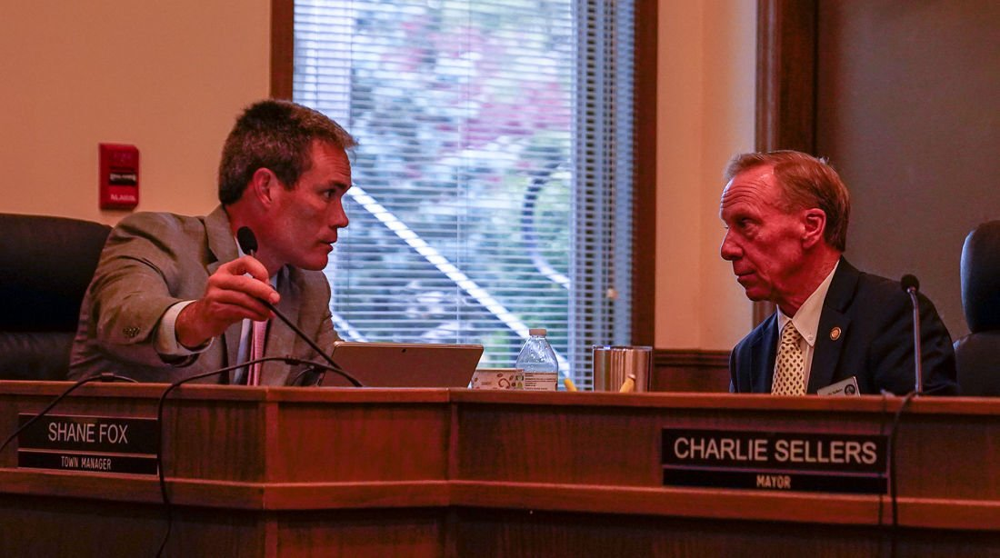 Shane Fox and Charlie Sellers in town council meeting