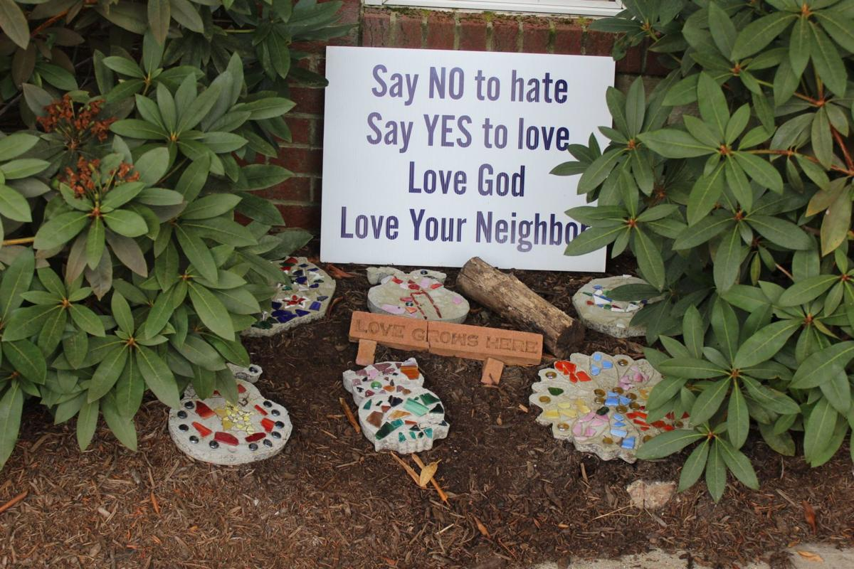 A small display with hand-decorated stepping stones just outside of the Deerfield Methodist Fellowship Hall reminds visitors that love is the most important part of a community.