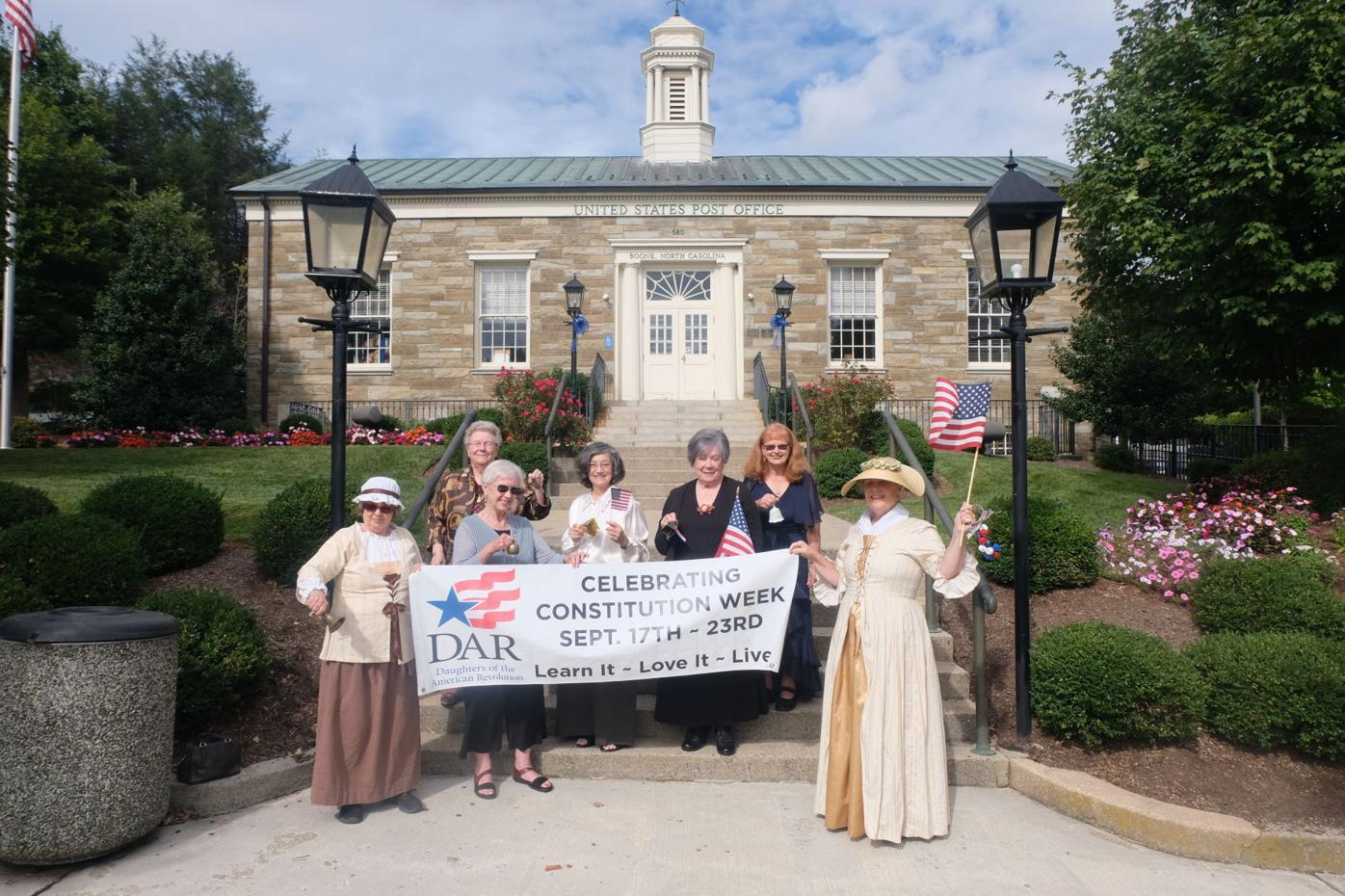 Daniel Boone Chapter NSDAR members celebrate Constitution Week in front of the old post office on King Street.