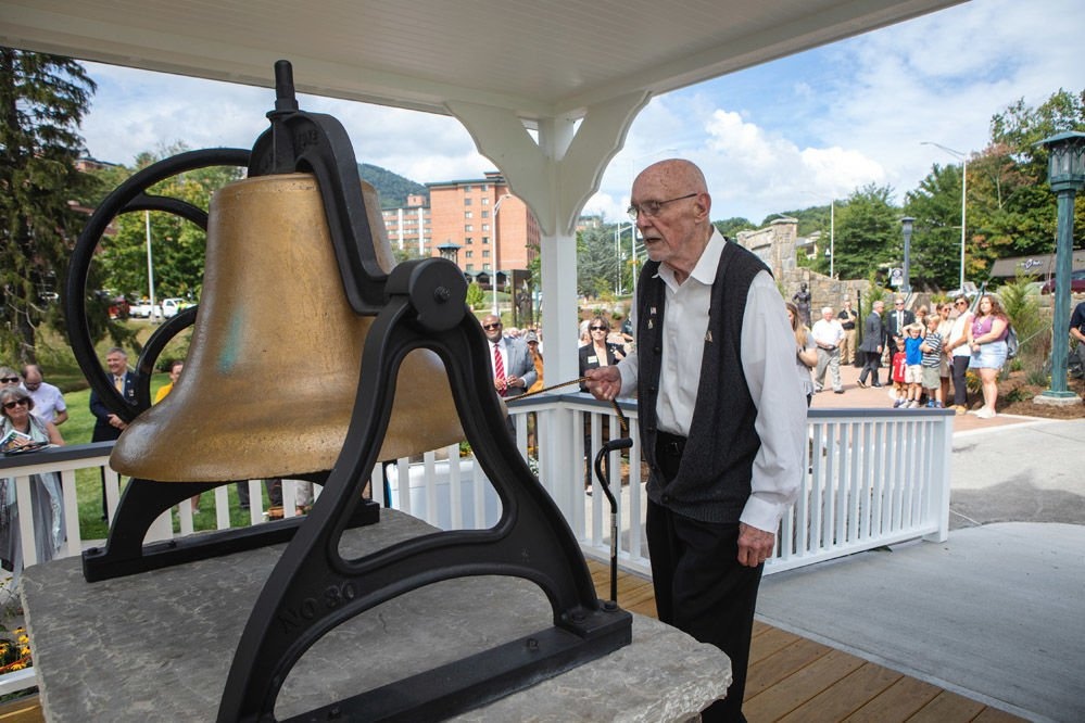 Former Chancellor John E. Thomas pulls the clapper rope to ring Founders Bell during the Founders Day Ceremony Sept. 5.