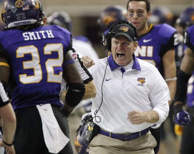 UNI head coach Mark Farley, right, celebrates a first down run by Tyvis Smith, left, during Saturday's FCS playoff game in the UNI-Dome. (Matthew Putney/WCF Courier)