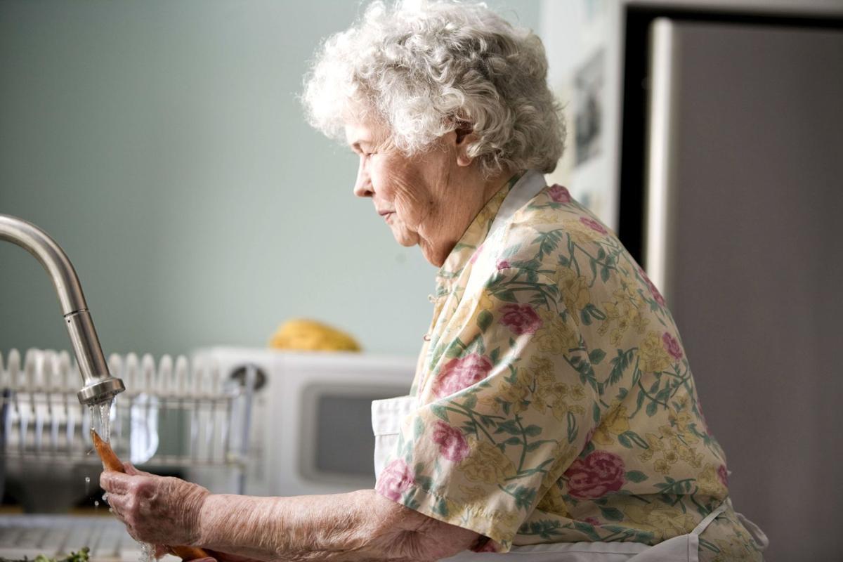 Senior woman washing produce