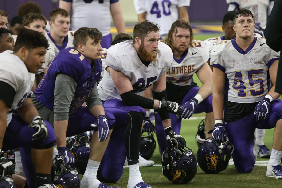 Seth Thomas kneeling