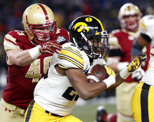 Iowa beats Boston College 27-20 in chilly Pinstripe Bowl