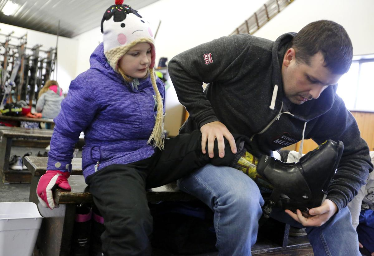 Adaptive skiing - Father helps daughter
