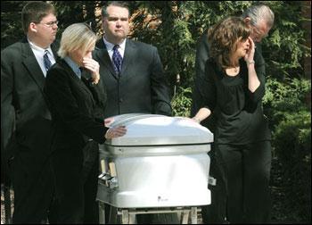 1,000 attend funeral for man, slain family