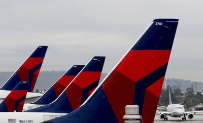 Delta Airlines aircraft are lined up at Terminal 5 in Los Angeles International Airport on Dec. 21, 2016. Delta has overhauled how it cleans airplanes and operates at airports to attract people back to flying.