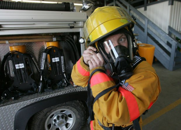 photo dunkerton firefighter tries on new gas mask local news