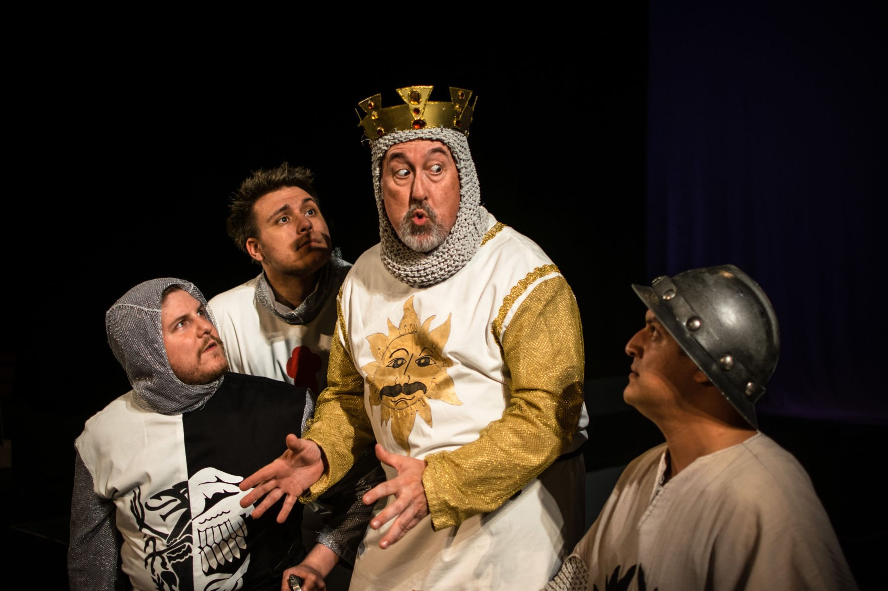 ... tells his Knights of the Round Table about their quest to find the Holy  Grail, in a scene from 'Monty Python's Spamalot.' From left, Jordan  Makinster, ...