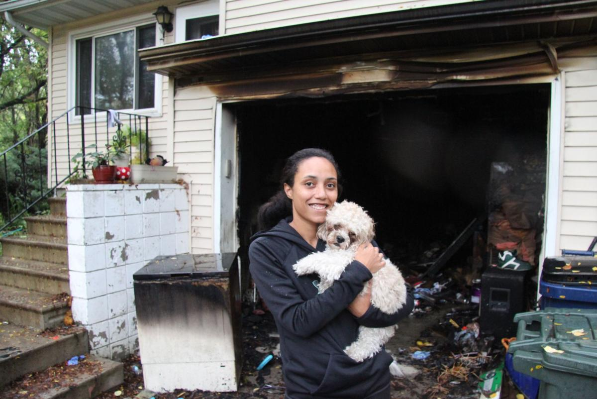 family escapes fire firefighters save dog local news
