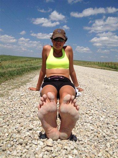 Iowa woman running barefoot across USA