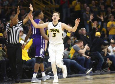 Bohannon, Iowa hold off Northwestern 77-70
