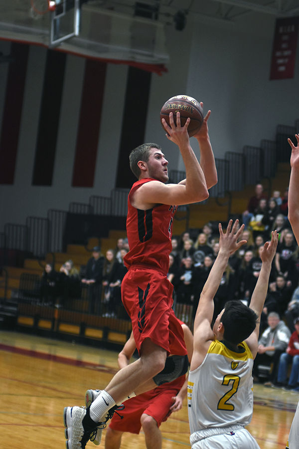 Justin Kuehl scores 28 points but Falcons fall to Crusaders 76-64 in OT
