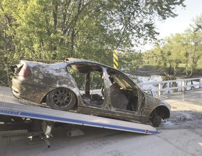 Swimmers find submerged car in Rock River