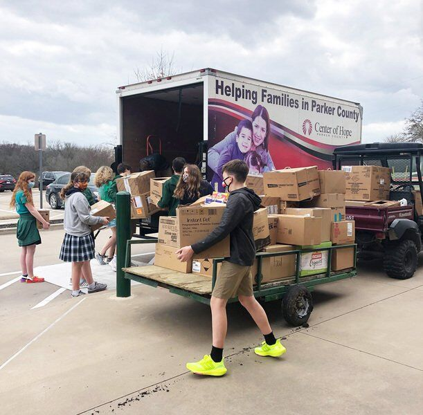 TCA students help locally while high schoolers on mission trip