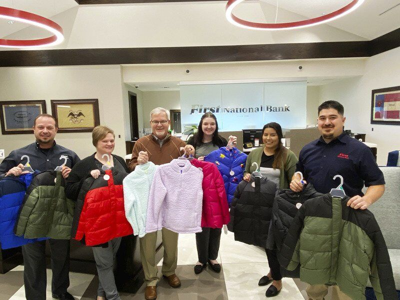 First National purchases coats for local students