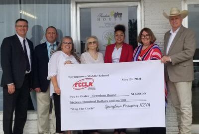 Springtown middle schooler donates $1,600 raised through club to Freedom House