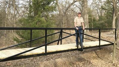 Boy Scout constructs bridge at Camp Holland for Eagle project