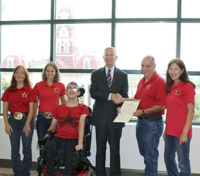 Phil King honors equine-assisted nonprofit therapy organization