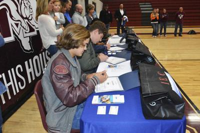 MHS seniors sign up for electrician apprenticeships