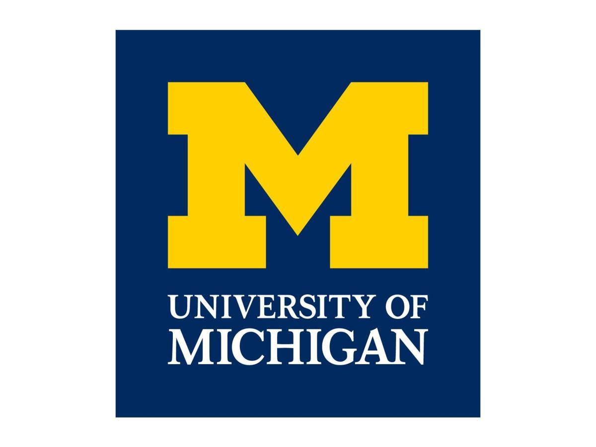 Univ  of Michigan fraternities suspends all social