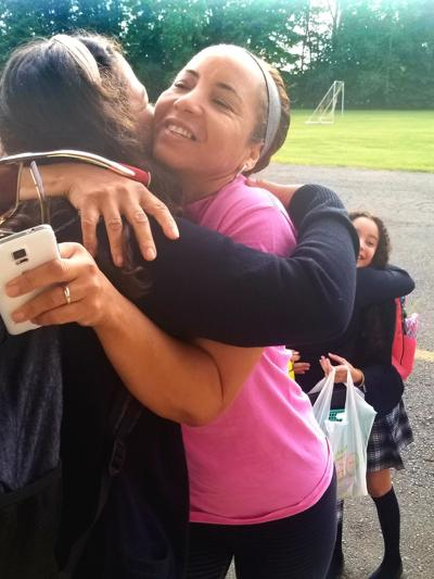 On first day of school smiles and hugs abound at St. Brigid-St. Augustine in West Hartford