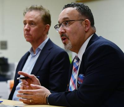 Editorial: More questions than answers on school plans