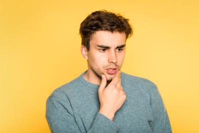 puzzled bewildered man think scratch beard emotion