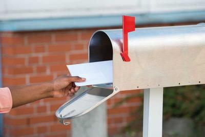 Person Putting Letters In Mailbox