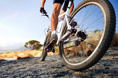 19141271 - extreme mountain bike sport athlete man riding outdoors lifestyle trail