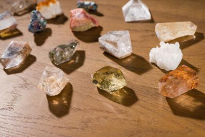 Collection of beautiful precious stones on wooden table.