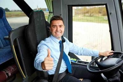 happy driver driving bus and snowing thumbs up