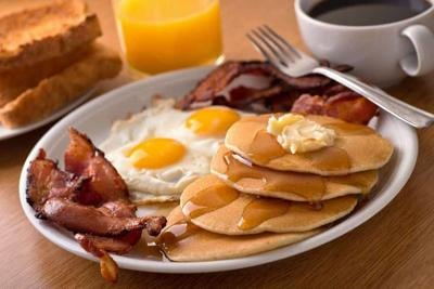 Breakfast with bacon, eggs, pancakes, and toast