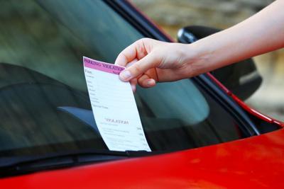Parking violation ticket on car windscreen