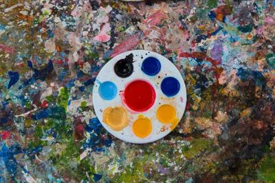 art palette with paint color on dry poster color texture