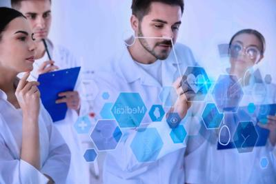 Medical students working with virtual screen in laboratory, color tone