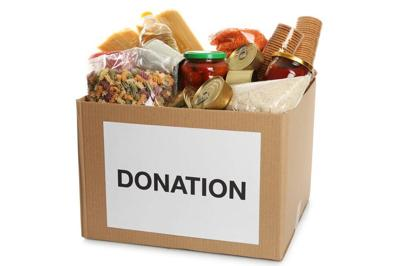 Donation box full of different products on white background