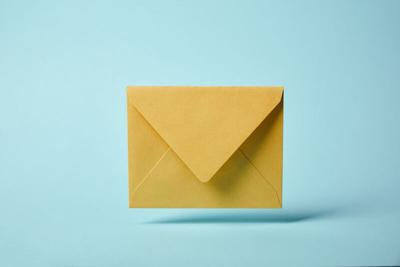 yellow and colorful envelope on blue background with copy space