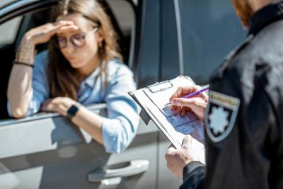 Policeman issuing a fine for a female driver