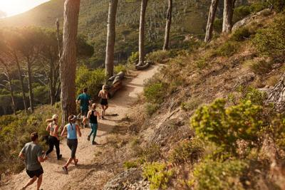 Group of people trail running on a mountain path