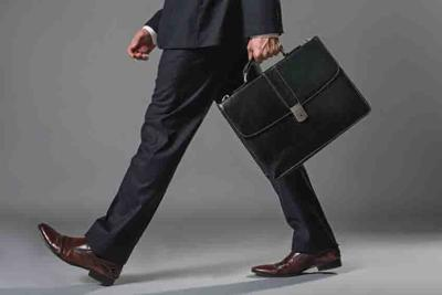 Young businessman going with a briefcase