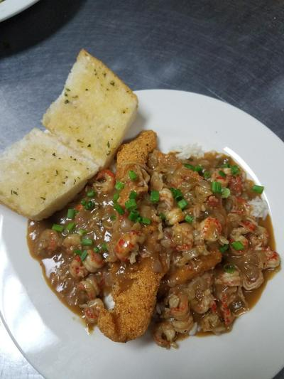 Cajun-style eatery Flavors of Louisiana boasts authentic Louisiana dishes in Avondale. Dunkin Catfish, pictured above, is a flavorful dish consisting of crawfish etouffee-soaked breaded catfish with white rice.