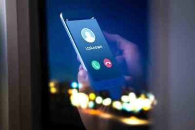 Unknown number calling in the middle of the night. Phone call from stranger. Person holding mobile and smartphone home late.
