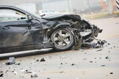 car crash accident on street, damaged automobile after collision in city