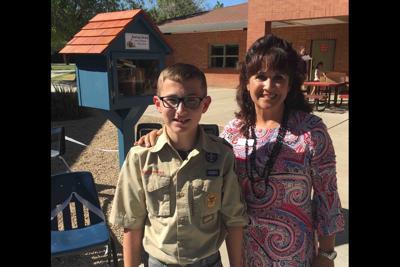 Scout Joel Cluff Jill Helland, principal at Garden Lakes Elementary in Avondale