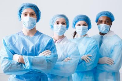 Surgeons Team Ready for Surgery. Practitioners Wearing Protective Uniforms