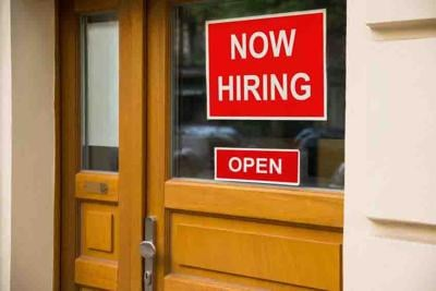 The Text Now Hiring Sticker Attached On Door